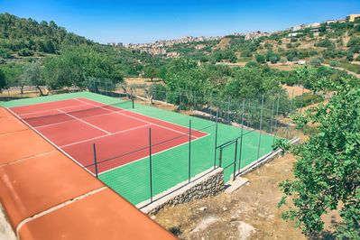 view from the pool patio overlooking the tennis court.