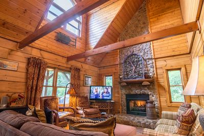 Living room with couches and chairs and gas log fireplace