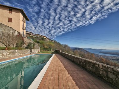 Photo for Flat by ancient charm with pool and lake view