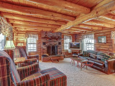 Photo for NEW LISTING! All-seasons riverfront log cabin with great views, cozy interior