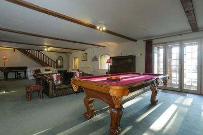 Full size American pool table in the lounge.