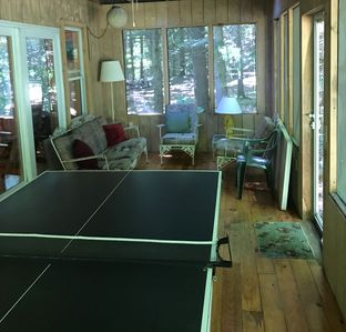 Ping-Pong table on screened porch.