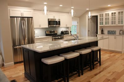 Brand new custom kitchen with beautiful quartz island for entertaining - seats 6