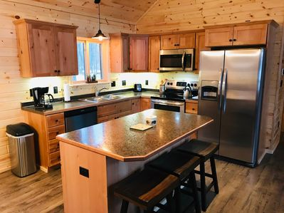 Our kitchen with large center island has everything you need.