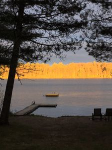 Photo for Level lake frontage! Sandy lakeside campfire area. Clean & comfy home.