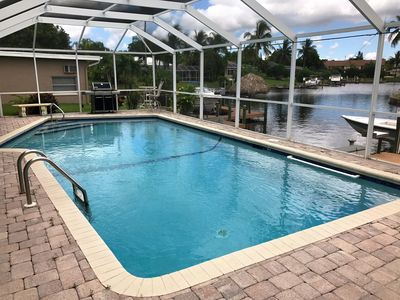 Photo for Waterside 3BR w/ Outdoor Heated Solar Pool, Dock, Lanai & Gourmet Kitchen