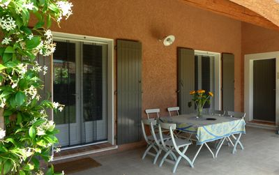 Front terrace with outside dining table. Insect screens on doors and windows.
