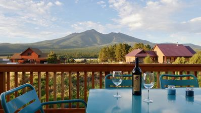 San Francisco Peaks views off the front deck with tables and seating for 8.