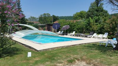 Pool with sun terrace and bar