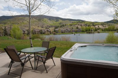 Soak in the private hot tub overlooking the pond