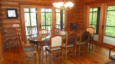 Dining room with attached screen porch. All with lake view