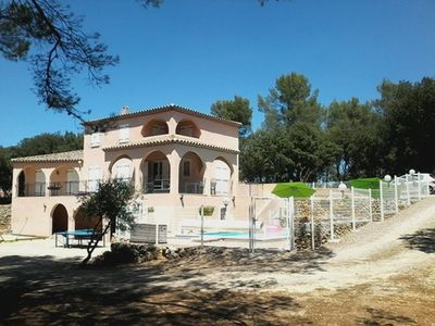 Photo for Beautiful Provencal house with pool, in the heart of an oak grove 7 kms / village