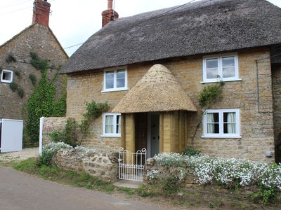 Photo for A beautiful Grade II listed thatched cottage with a walled garden.