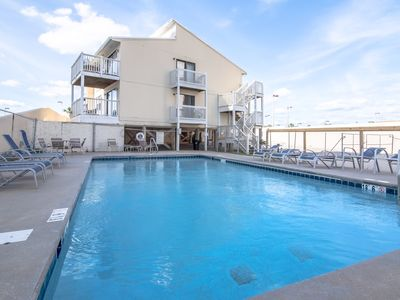 Photo for New Listing! Gulf side condo w/free WiFi, shared pool, and beach access!