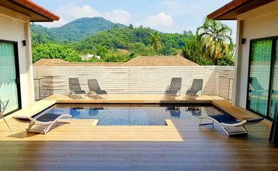 Tranquil private swimming pool with integral jacuzzi, adjacent to BBQ and soft seating area