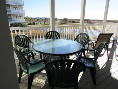 furnished shaded deck with ocean views