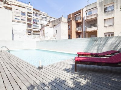Photo for Apartment Barcelona Rentals - 2 duplex w/terrace & pool in the centre -Free WiFi