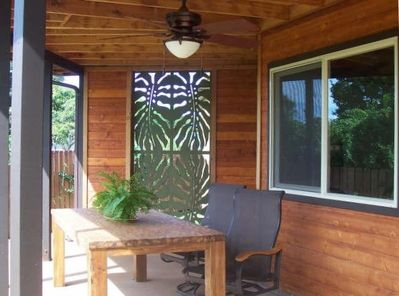 Outside Lanai with Teak Table and Swivel Rocker Chairs