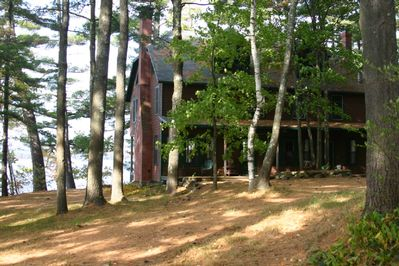 View of the house with the lake just beyond.