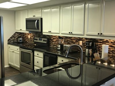 Full Stocked Kitchen with Stainless Steel Appliances, black granite counter-top!