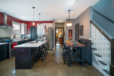 Open-concept home featuring kitchen and dining area adjacent the living room.
