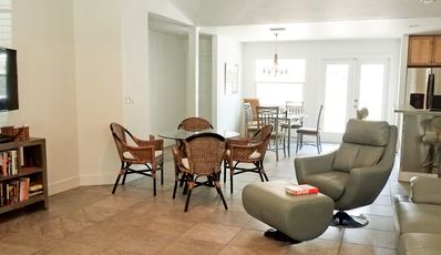 Spacious living space. Open floor plan. Smart TV. Game table.
