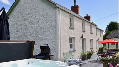 Photo for Ty Hugh - 18th century farmhouse with modern comforts and wonderful facilities