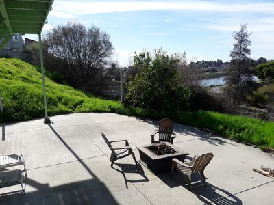 Cement Patio below deck. Sit by the firepit at night and enjoy the city lights.