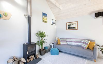 Photo for A cosy beach house only a stone's throw away from the beautiful Langland Bay