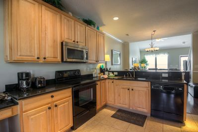 Extra tall cabinets and granite countertops in the kitchen