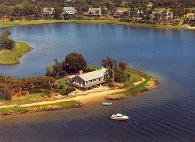 Aerial view of home on private peninsula, and private beach on Bass River estuar