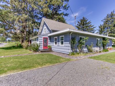 Photo for Beautiful, dog-friendly cottage w/ large yard - just a few blocks from the beach