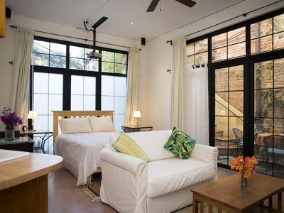 Photo for Charming High Ceiling, light-filled Studio in the town center with garden space