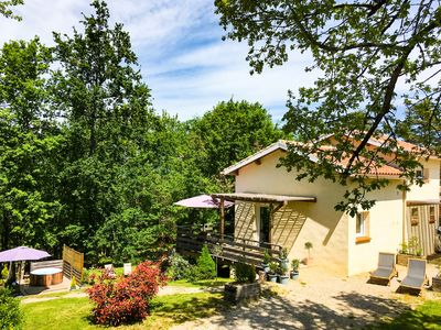Photo for Beautiful cottage quiet in the woods with SPA