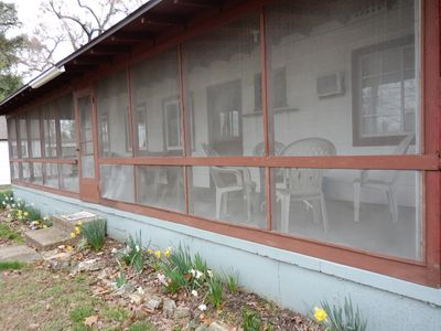 The large screened in porch overlooking the lake