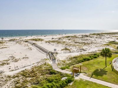 Photo for NEW LISTING! Contemporary beach-side escape w/shared hot tub, gym and pools