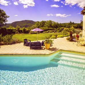 The pool, sun terrace and views of the hills