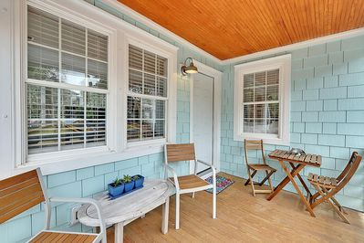 The shady front porch is great for morning coffee or happy hour drinks.