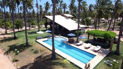 Photo for Beautiful house of charm with 4 air-conditioned suites, in the Beach of Guajirú - CE.