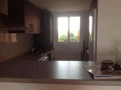 Kitchen with dishwasher, fridge freezer, hob, oven, extractor, washing machine