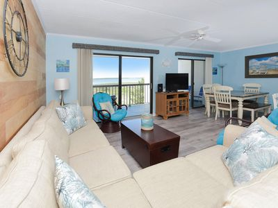 Photo for Impeccably styled with coastal decor, this 2 bedroom luxury condo has free WiFi, HBO channels, and a heated outdoor pool and is located right by the bay!