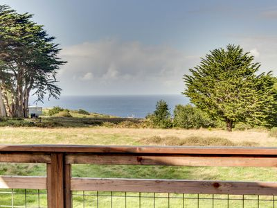 Photo for Cozy cottage w/ big deck, ocean views & 8 shared acres - near trails & beaches!