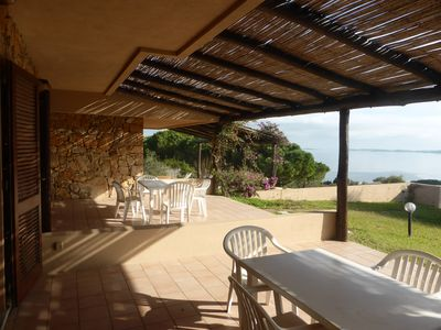 Photo for Independent villa with evocative Sea view in the Porto Mannu complex