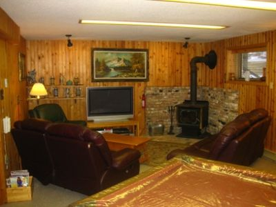Entertainment Room with Wood Stove, Large Screen TV and Movies Galore!