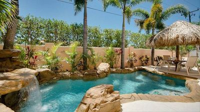 Photo for Heated Tropical Pool/Waterfall 4Bed/3Bath Sleeps 10, Steps to Beach, Free Trolly
