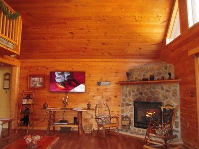 Large Flat Screen TV with DISH receiver Rockers by the gas fireplace