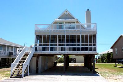 Water front exterior with screen porch & second floor open deck.