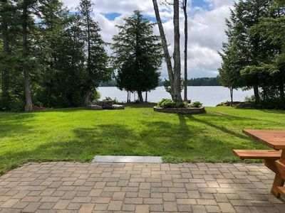 Patio view of the lake and fire pit