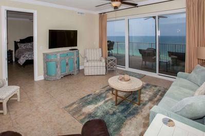 Living room w/flat screen TV and beautiful Gulf views