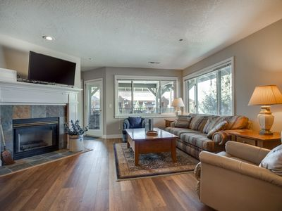 Photo for Cozy condo w/ fireplace, shared indoor pool & marina views!